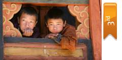 3rd place, two boys watch a ceremony in Bhutan (Scott Carroll)